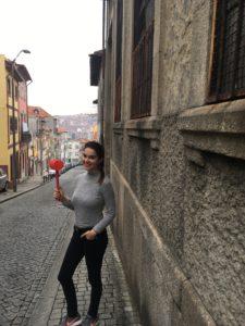 How To Celebrate São João like a true Tripeiro - girl holding a plastic hammer