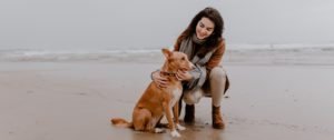 Girl with Dog at the Beach
